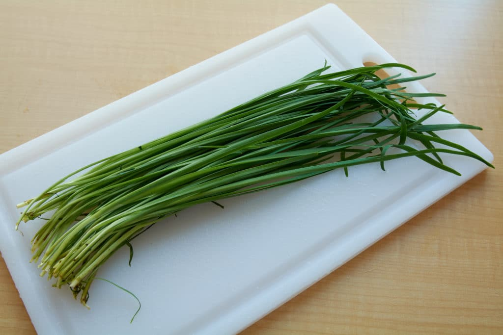 Fresh chives on a cutting board