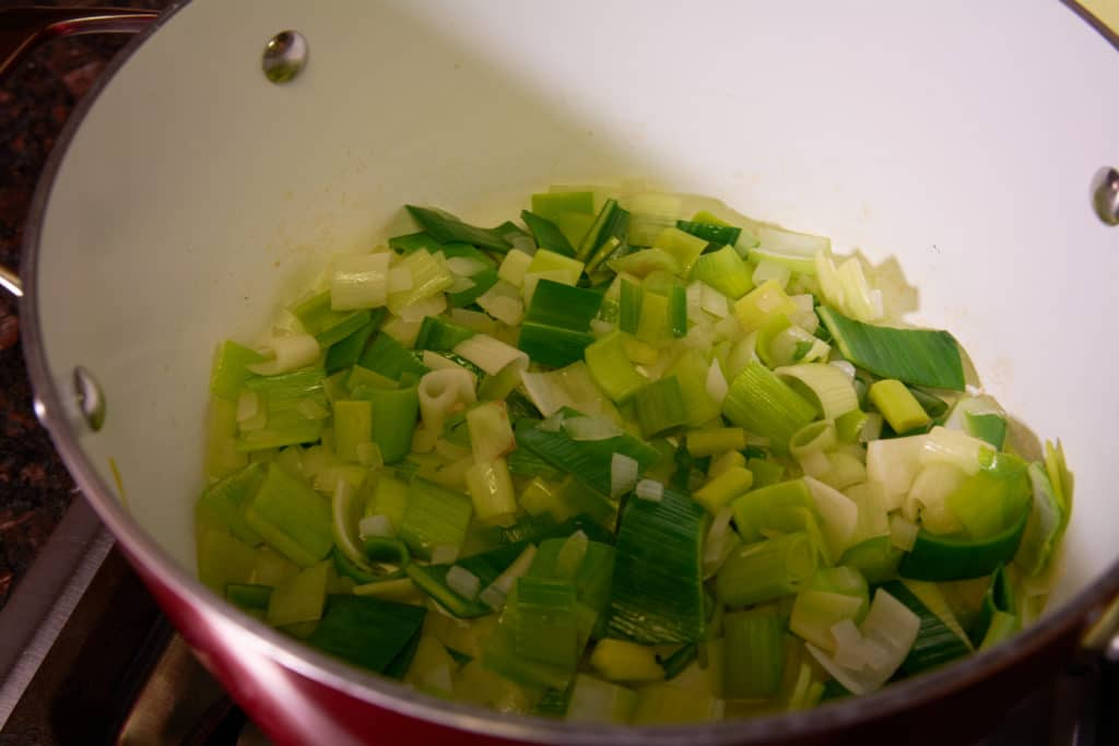 Pot with cut up leeks being cooked
