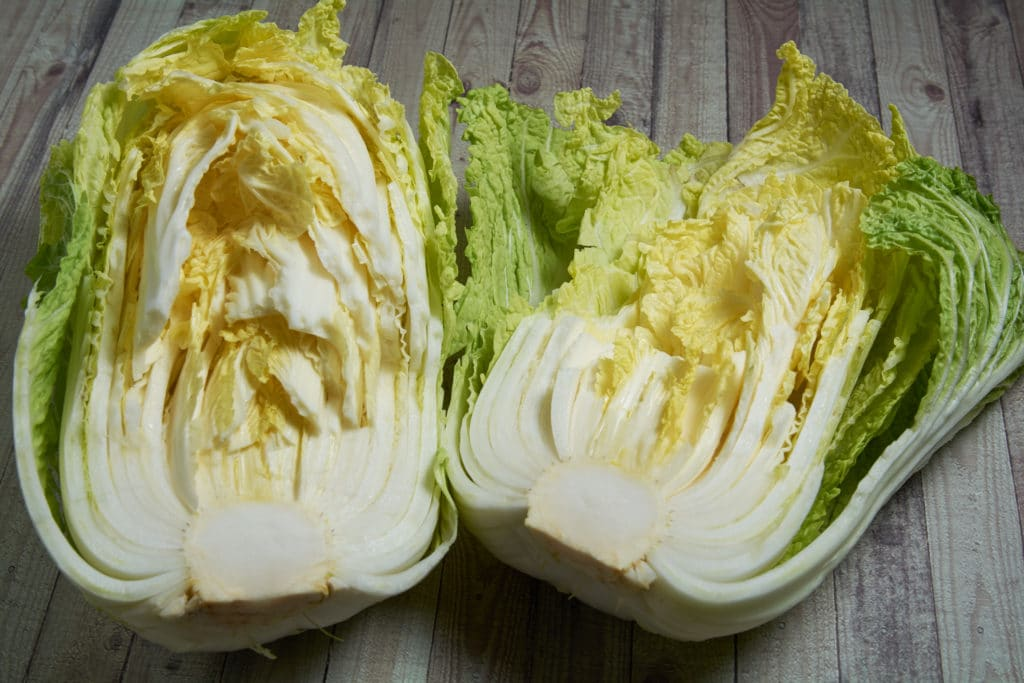 A head of cabbage that has been split into two pieces