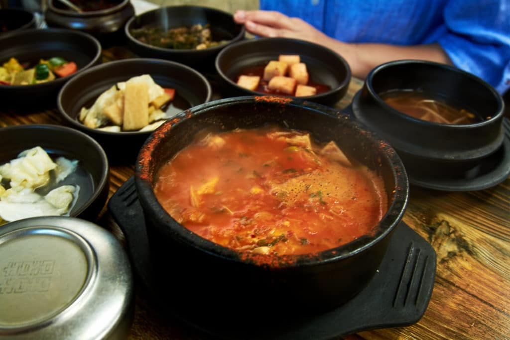 Table with Korean food including soup