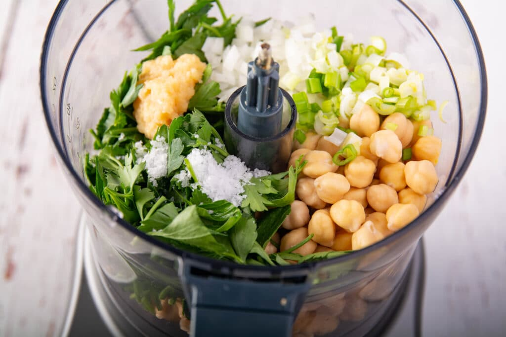 Food processor with falafel ingredients