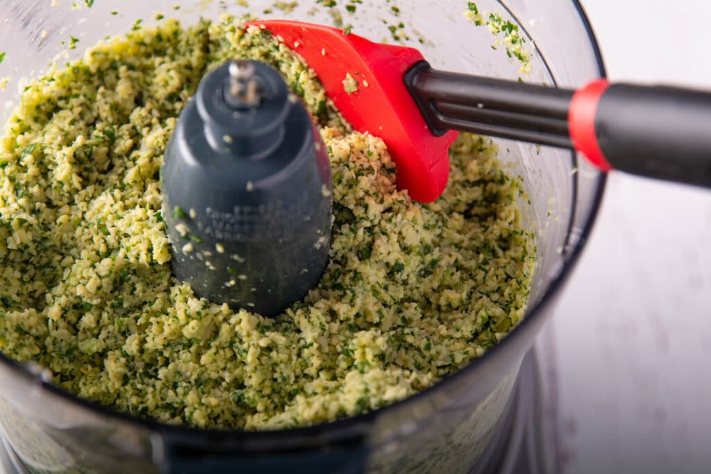 Food processor with ground up falafel ingredients