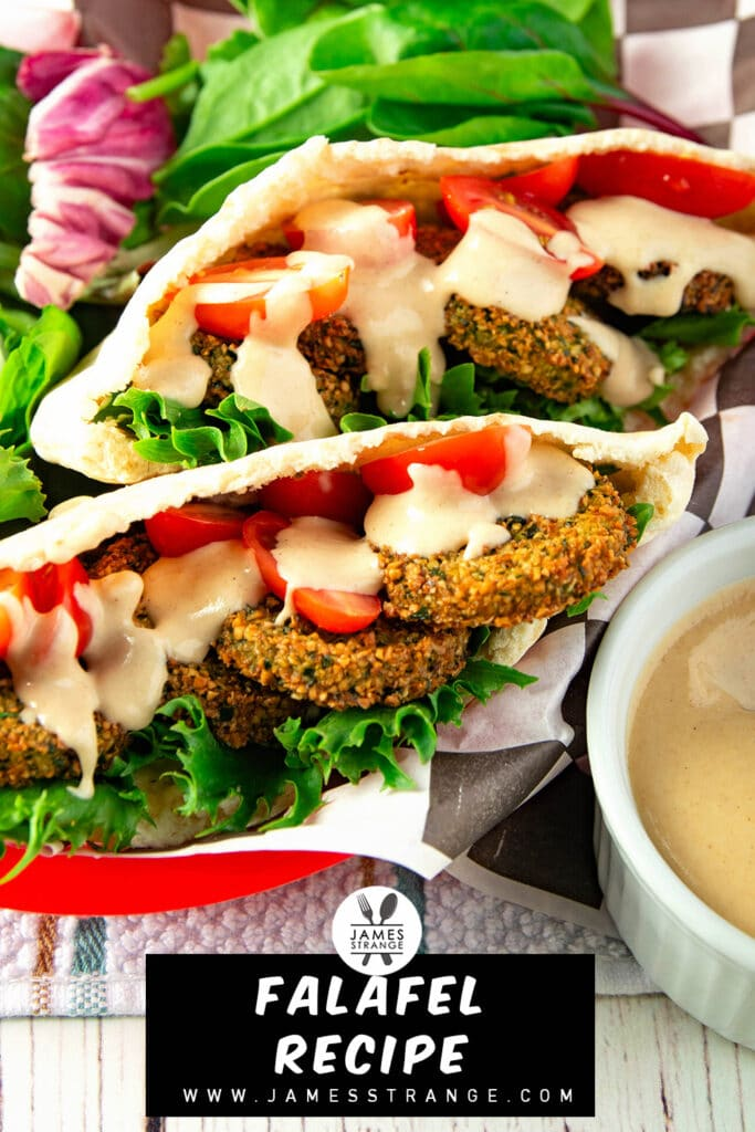 Falafel sandwich in a basket with sauce on the side. this is for pinning to Pinterest