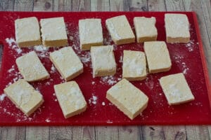 Tofu sprinkled with cornstarch on a cutting board