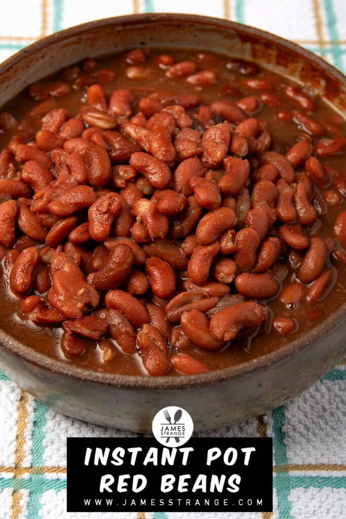 Cooked red beans in a bowl sitting on a towel.