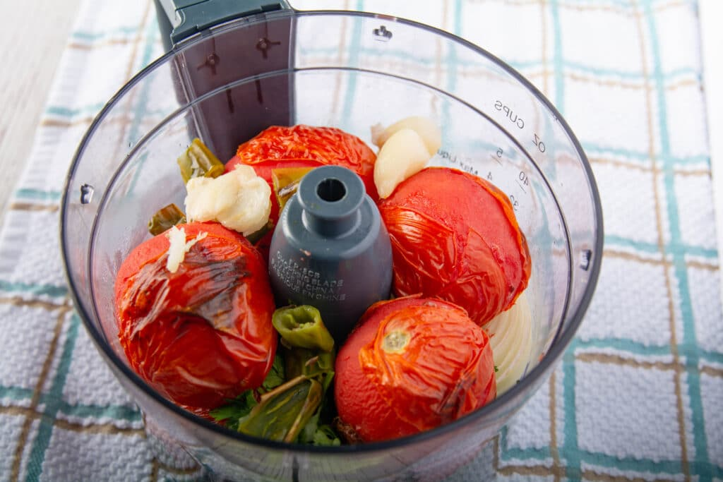 Salsa ingredients after cooking in the airfryer in a food processor ready to chop.