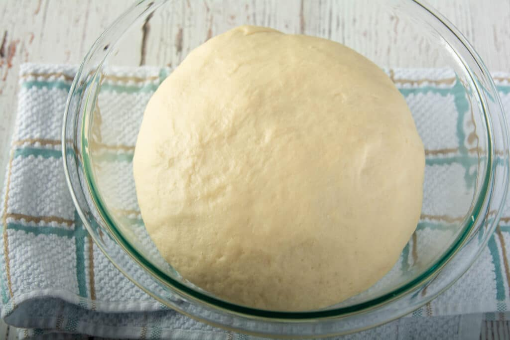 Ball of dough in a glass bowl