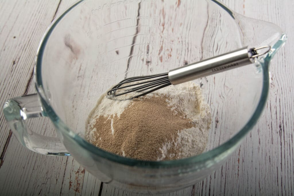 Dry ingredients is a glass bowl with whisk