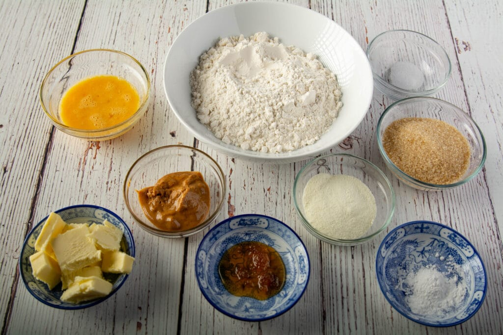 Crumb topping ingredients on a table in bowls