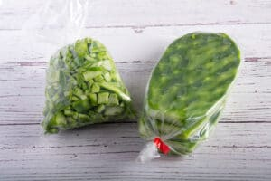 Nopales in bags, one bad is cut up and one one bag only has the thorns removed.