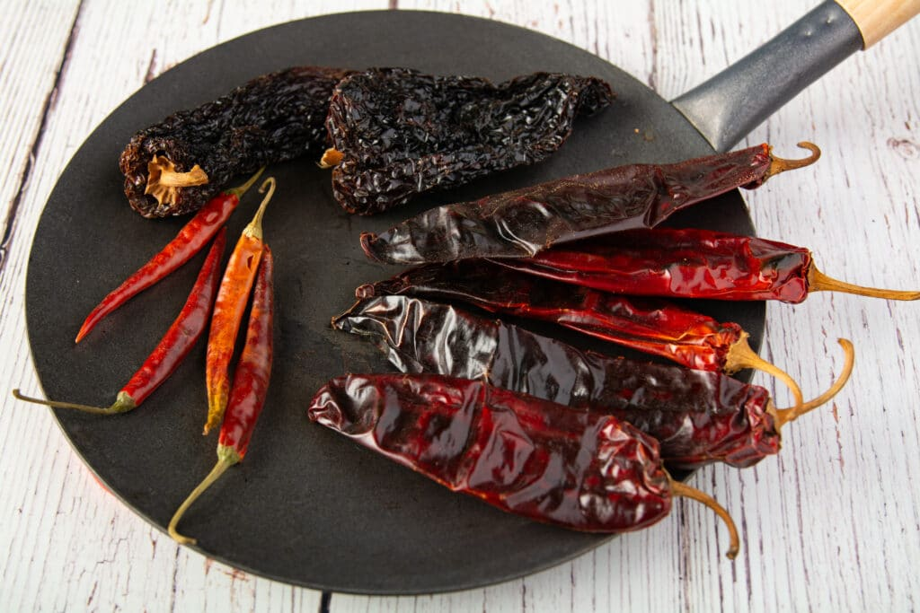 Dried chili peppers on a flat pan