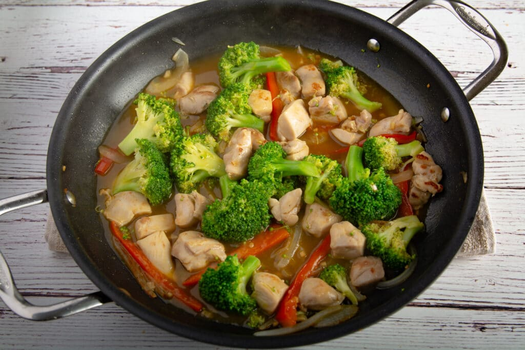 Finished chicken and broccoli in a pan on a table