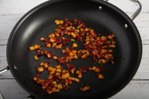Cooked onions, garlic and tomato paste in a pan