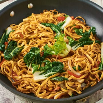Simple vegetable chow mein in a pan on a table