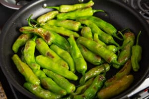 Peppers frying in a pan