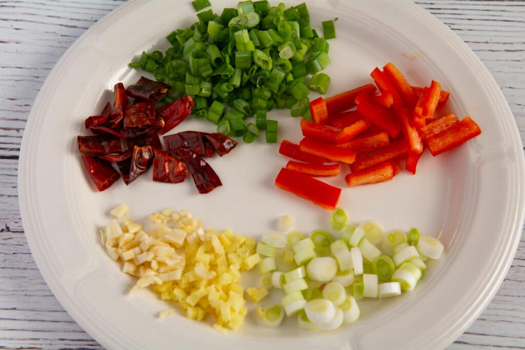 Vegetable ingredients prepared and on a plate