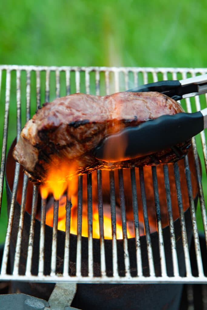 Steak cooking on a grill, cooking the sides
