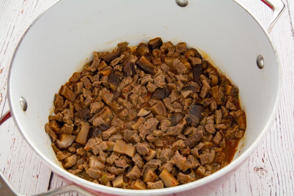 Diced beef in a pot after boiling.