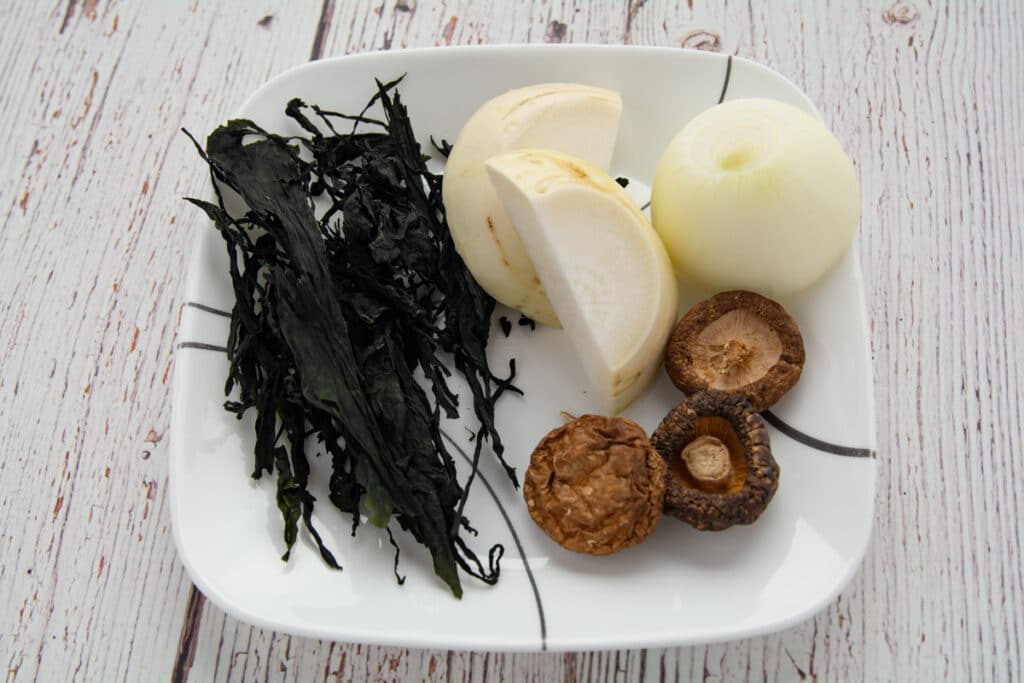 seaweed, dried mushrooms and mu on a plate
