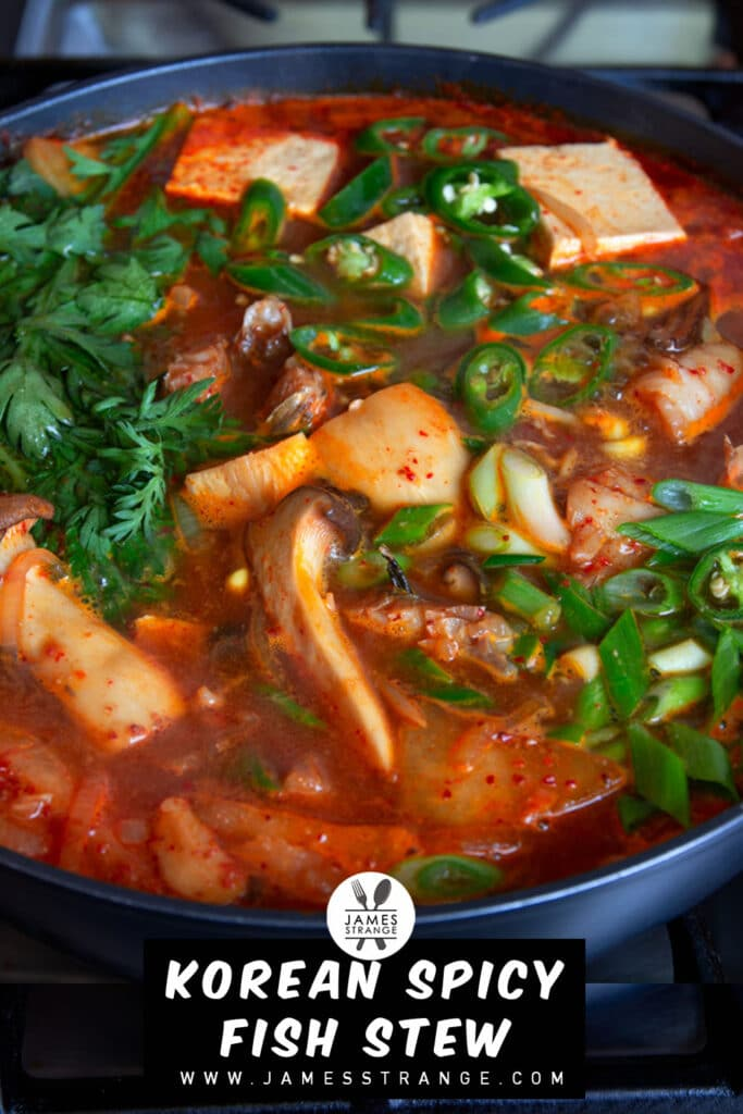 Spicy fish stew cooking on a stove. This is a pin for Pinterest