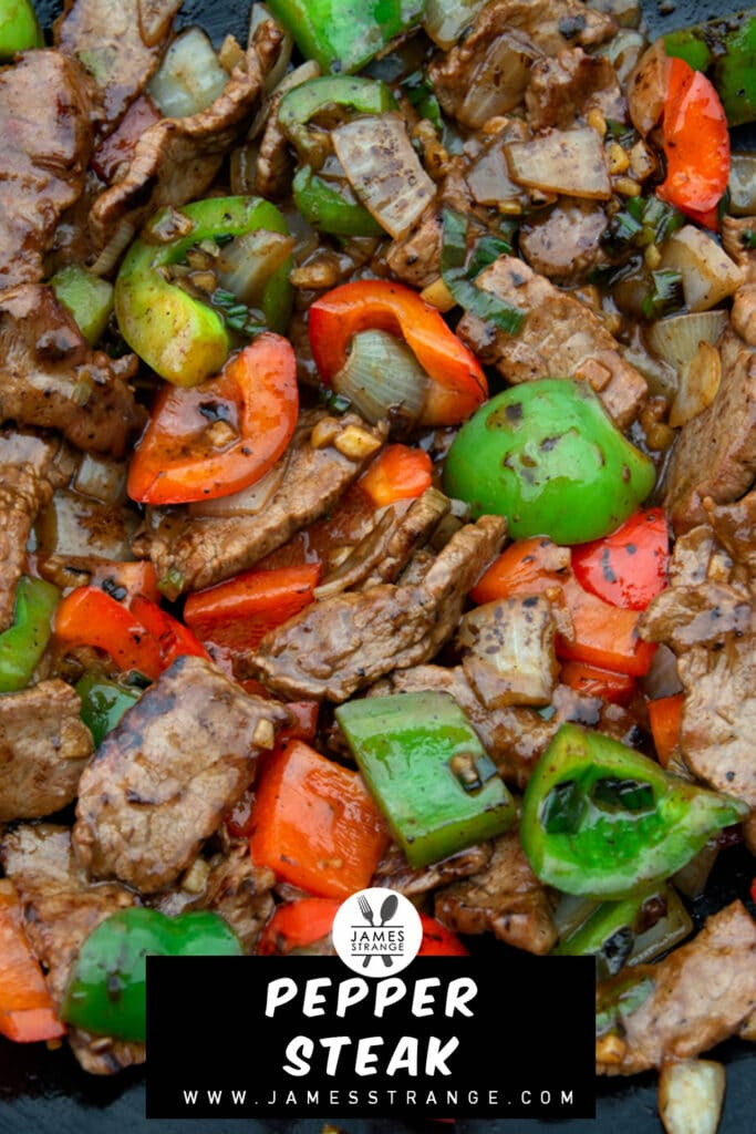 Closeup of stirips of steak stirfried with bell peppers and onion. This is a pin for Pinterest.