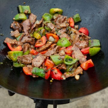 Finished pepper steak in a wok