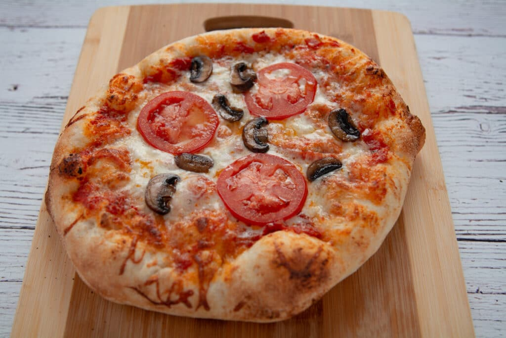 Tomato, cheese and mushroom pizza fresh out of the oven.